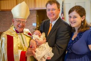 My family with Bishop Loverde at my son's baptism (photo credit: Stacy Rausch)