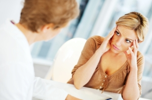 Worried woman visiting a psychologist.