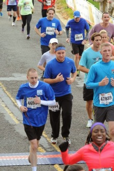 Father Edward Horkan (bottom left) racing for seminarians in the 2013 MCM 10K.