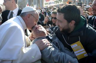 Pope Francis Embraces Man