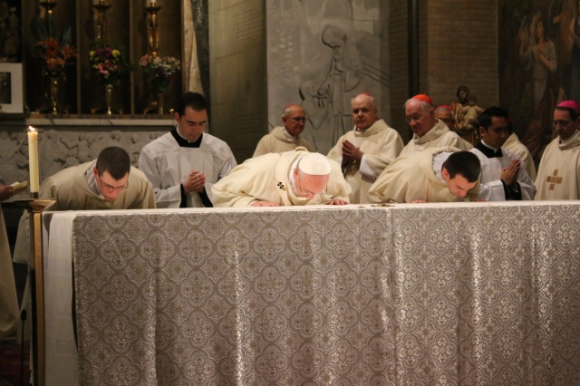Rev. Rich serves as Deacon of the Alter, pictured here bowing to the left of the Holy Father. (Photo by Michael Lund)