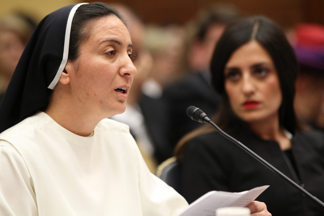 """Sister Diana Momeka, a member of the Dominican Sisters of St. Catherine of Siena in Mosul, Iraq, testifies at a May 13 hearing on Capitol Hill in Washington titled """"Ancient Communities Under Attack: ISIS's War on Religious Minorities."""" (CNS photo/Bob Roller) See ISIS-HEARING May 13, 2015."""
