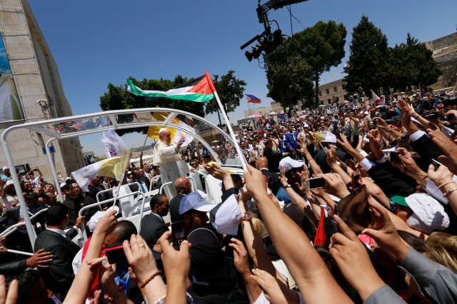 Pope Francis waving for the people after the mass in Bethlehem.