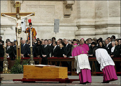 Archbishop Piero Marini, left, master of the liturgical ceremonies, bows to the casket of Pope John Paul II during the Pope's funeral Friday, April 8, 2005, in St. Peter's Square. White House photo by Eric Draper